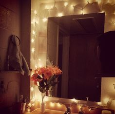 an intimately decorated college dorm bathroom. like the Christmas lights. Make a good nightlight!