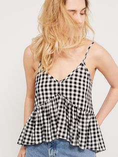 the classic peplum top gets a new season update with this all-over gingham design. suspended from skinny cami straps, the style features a plunge v-neck and floaty peplum hem which sits flatteringly on the waist. stay true to the prairie vibe with denim cut-offs, or square up to the pattern with a pair of ripped skinny jeans.main fabric: 100% viscoseitem no. 72167