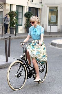 Love her outfit....and the bicycle.