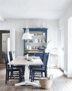 white cottage style dining room with marine blue hutch, pantone riverside, indigo, navy blue, light wood floor, black chairs