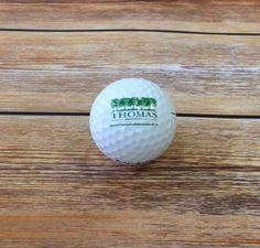 Golfballen voorzien van eigen logo voor Thomas dienstverlening