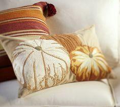 Pumpkin embroidered lumbar pillow.