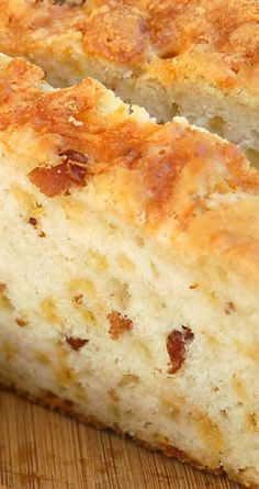 Bacon Cheddar Beer Bread ~ A simple no-knead recipe that is mixed with a spoon and ready to go in the oven before it is done preheating! Loaded with cheese and bacon this is a winner!