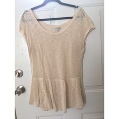 American Eagle Knit Peplum Top gently worn, good condition. good in between weight for warmer weather. knit fabric. name is crossed out because it was purchased at a discount store. American Eagle Outfitters Tops Tees - Short Sleeve