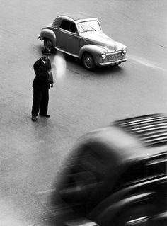 hauntedbystorytelling: Robert DOISNEAU :: Traffic policeman, place de la Madeleine, Paris, 1950-1951