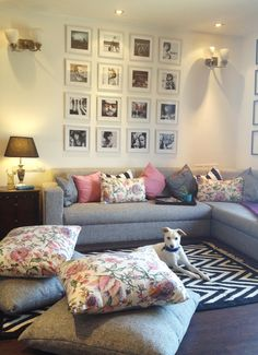 casual chic, grey sectional, oversized pillows, organized framed photos.