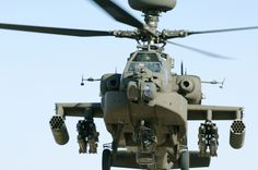 The Boeing AH-64 Apache is a four-blade, twin-engine attack helicopter with a tailwheel-type landing gear arrangement, and a tandem cockpit for a two-man crew. It features a nose-mounted sensor suite for target acquisition and night vision systems. It is armed with a 30 mm (1.18 in) M230 Chain Gun carried between the main landing gear, under the aircraft's forward fuselage. She first flew in 1975 and continues to serve in the US and around the world.