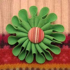 Green ric rac flower with covered button