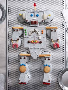 Robot cake! Cupcakes with graham cracker frosted for large body pieces, and other snacks etc on it http://www.ivillage.ca/food/recipes/easy-kids-birthday-cake-ideas#tools