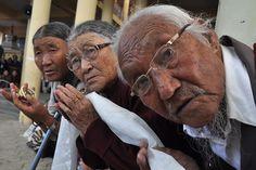 Week of Sept 20-26, 2014 Tibetan devotees waited for their spiritual leader, the Dalai Lama, to arrive at Tsuglagkhang, the main temple in McLeod Ganj, India, on Wednesday. Sanjay Baid/European Pressphoto Agency