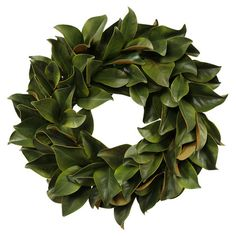 Add an organic touch above your entryway console or living room mantel with this faux magnolia leaf wreath, perfect for highlighting vibrant decor or complem...