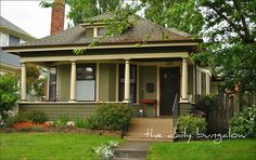 Olive exterior paint color scheme.  Love the front porch, too!