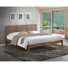 Offers both durability and beautiful grain to create a visually impressive finish in walnut, the Daylan Platform Bed is constructed of eco-friendly solid rubberwood.