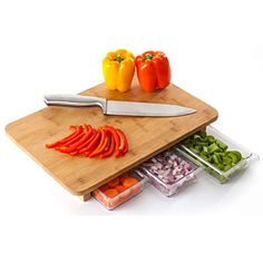 Raised cutting board with storage drawers underneath Bamboo surface treated with mineral oil, durable and beautiful Three prep drawers pull out so you can slide chopped food in them