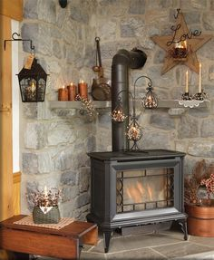 cast iron stove in the corner of the living room... I like the stonework around the stove with the rustic accents.