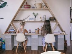 I wouldn't use cinderblocks for legs, but I love the triangle top. I would build something with drawers.