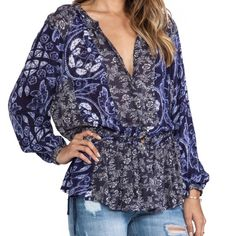 Free People floral blouse Gorgeous and flattering Free people floral blouse. Fits all sizes. Tie waist details. Worn exactly once. Perfect Spring top! Free People Tops Blouses