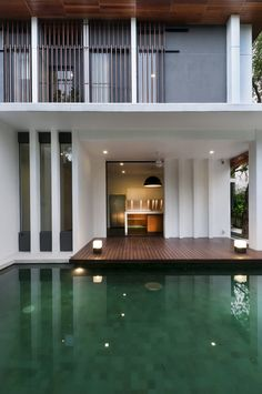 Twenty-Nine Design recently unveiled their latest architectural work, on a small residential plot in the city Kuala Lumpur, Malaysia. Hijuana House is a two story luxury home developed using green design techniques. Built around mango trees, great Style At Home, Exterior Design, Interior And Exterior, Wooden Decks, Wooden Terrace, House With Porch, House Deck, Tropical Houses, Pool Designs