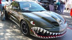 Check out the 50 most interesting custom car wraps we& ever seen. See the coolest and funniest van, truck and car custom wraps. Airbrush, Military Paint, Shark Mouth, Car Paint Jobs, Custom Wraps, Expedition Vehicle, Pontiac Firebird Trans Am, Nose Art, Car Painting