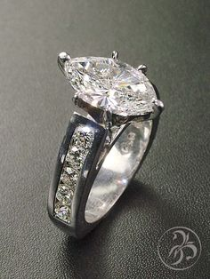 Engagement ring with 2.86ct marquise diamond and channel set band. 18k white gold.  Custom created by Redford Jewelers in Salt Lake City.