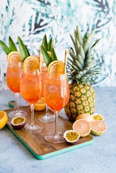 Tropical Rosé Aperol Spritz Cocktail Recipe by Shanna of Pineapple and Coconut – Cocktails and Pretty Drinks Spritz Cocktail, Cocktail Rose, Cocktail Garnish, Cocktail Drinks, Cocktail Recipes, Alcoholic Drinks, Beverages, Pineapple Cocktail, Passion Fruit Juice
