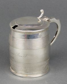 Lot 519, A George III silver mustard pot in the form of a barrel London 1814 124 grams, est £100-150