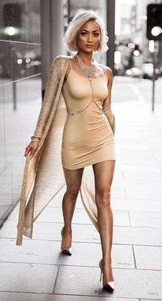 all nude and gold. bodycom mini dress. bodychain. lurex maxi cardigan. sexy going out party style.