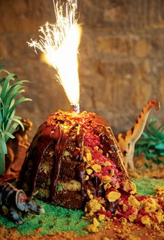 LOVE this idea. Use 4 sparkler candles to top the volcano on the dinosaur cake (the skinny sparkler candles from Party CIty, not the fountain candle like pictured).