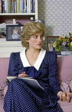 October 6, 1985: Princess Diana at home In Kensington Palace..pic of William in the background... cute