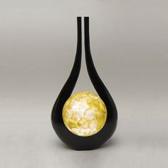 Black Fork Lamp: These wonderful fork lights add interest and a lovely warm light to any room. A taller version in black is also available.