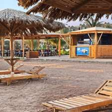 Beach Kiosk bar || Just a step from the sandy private beach at the Hilton Hurghada Plaza hotel is this open-air Hurghada bar. A wooden kiosk overlooking the Red Sea, it serves refreshing local beers, wines and spirits. After a spot of sunbathing, cool down with an ice cream.