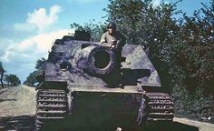 Color photo of an American soldier posing on a Sturmtiger Self Propelled Artillery, Luftwaffe, Tank Armor, Ww2 History, Tiger Tank, American Soldiers, Toy Soldiers, Ww2 Tanks, Military Diorama