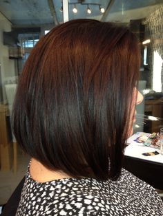 Long bob with a slight graduation and long layers to give movement . HAIR by Martine