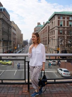 Leopard pants from Zimmermann, shirt from Zara and grey leopard Nike Free 5.0 sneakers.