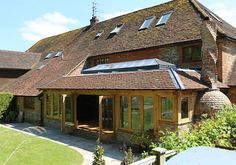 Julius Bahn specialises in building exceptional oak-framed structures including orangeries, garden rooms, conservatories, garages, outbuildings and stables. Cottage Extension, House Extension Design, Roof Extension, Extension Ideas, House Design, Lantern Tile, Roof Lantern, Oak Framed Extensions, House Extensions