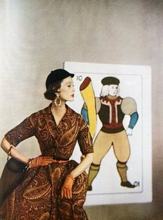 A fashion spread in Harper's Bazaar, August 1953, featuring over-sized tarot cards. Photos by Louise Dahl-Wolfe.
