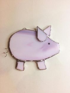 These are little stained glass pigs with little curly wire tails, made to hang on your window with the sucker provided. They measure about 10cm across and are all handmade by me in my home workshop. These have been my best selling item so I have made a few in some different shades of