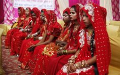 An Indian bride yawns as she waits with others for the rituals to begin before a mass community marriage in New Delhi, India, Feb 27, 2014. Thirteen couples were married in a mass marriage .