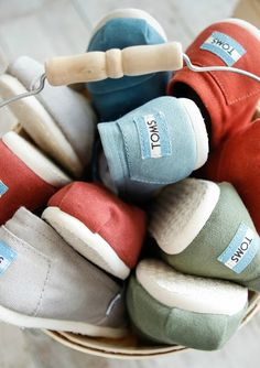 TOMS shoes come in blue, red, green and many other colors and patterns, but they all have the same give. Buy a pair and a child in need receives a pair.