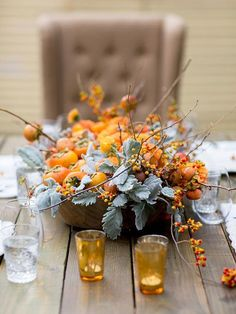 Flower shops may not be as colorful this time of year, so look to seasonal plants to add some wow-factor to your Thanksgiving centerpiece. Plus get more fall table decorating ideas.