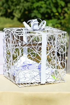 I love this present shaped gift card box for birthday parties, baby showers, or even a graduation party.  The best part is it's already assembled so I don't have to lift a finger or DIY a thing.  It's already a cute decoration as is. Order here http://www.tippytoad.com/metal-scroll-gift-card-box-holder.asp