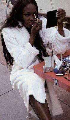 Vintage backstage pic of Naomi Campbell doing her makeup. Check out the giant cell phone! #90sbaby