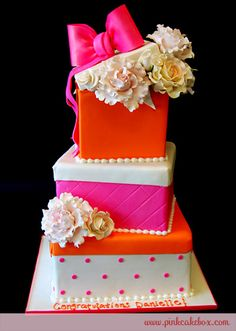 To add a touch of whimsy, we spiced up the color scheme of this cake using a much brighter color palette of pink and oranges