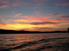This is a sunset at Lake of the Ozarks, Missouri. This is one of my favorite places to go and the sunset makes it that much more special. My family has a condo on the lake and we love to go and jetskii in the summer. It is a very relaxing place.