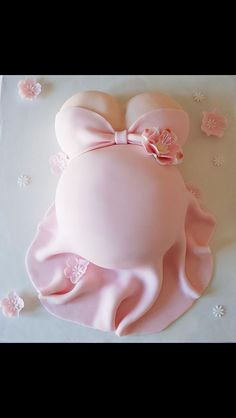 Absolutely cute baby shower cake! Girl needs to cover up some of that cleavage though!!