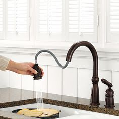 The Most Useful Faucet. A gooseneck with pull-down sprayer stands high enough to accommodate lobster pots and cookie sheets, works in both traditional and contemporary kitchens, and comes in an array of finishes and designs from just about every major manufacturer.