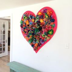 i went to my friend @paperoranges house and she has this giant, stunning, wooden neon heart up on the wall, filled with paper flowers. it's a collaborative piece made at her children's school. the kids made all the flowers!! just WOW. i'll post a close up next.