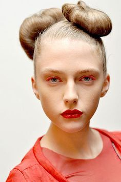 """SPACE AGE KNOTS--HOW TO """"This look can be sectioned in any way,"""" says Ramirez. """"Two knots make it classier and three knots will give you a more funky and daring look. Latest Hairstyles, Pretty Hairstyles, Red Eyeliner, Red Eyeshadow, Colored Mascara, High Fashion Hair, Wacky Hair, Hot Hair Styles"""