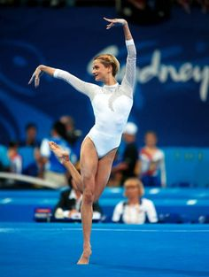 The words tallest gymnast! She was literally ROBBED in Sydney:( They set the vault too low and for someone her height it was a disaster. She performed perfectly on every other apparatus.