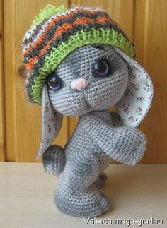 Amigurumi bunny in a knited hat. (Available to purchase, outside of uk).